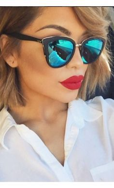 Three things going ON in this picture—of course the sunnies! But the lipstick & the fierce eyebrow arch also. Total pic is a W!