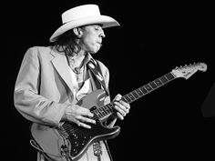1985 — Late guitar great, Stevie Ray Vaughan at the Chicago Blues Fest –Image by © Kirk West  https://theselvedgeyard.wordpress.com/2012/09/01/the-photography-of-kirk-west-music-legends/