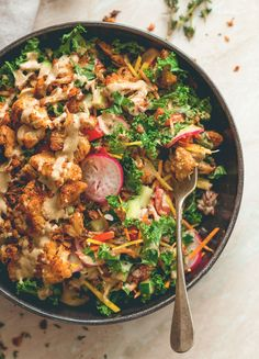 Cajun Roasted Cauliflower Salad - I love cajun seasoning on roasted vegetables. This salad is perfect for this time of the year. Cauliflower, mixed salad, and tahini dressing. (vegan, GF) http://thehealthfulideas.com/cajun-roasted-cauliflower-salad/