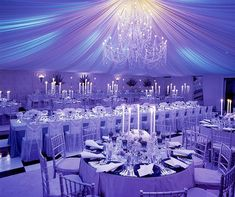 Fabulous #purple #uplighting look at this #wedding #reception ! Love the #candle #centerpieces and the #draping ! #DIY #inspiration #ideas #chandelier