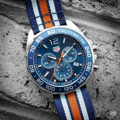 The new TAG Heuer Formula One Chronograph radiates with a colorful dial to match its blue, orange and grey stripped NATO strap. Coming very soon. #DontCrackUnderPressure #reloj #watch