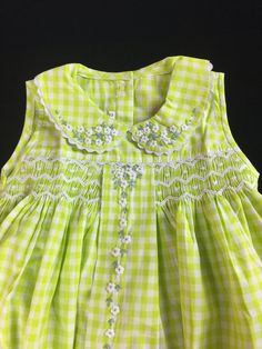 Lime green gingham frock with hand embroidered daisies.