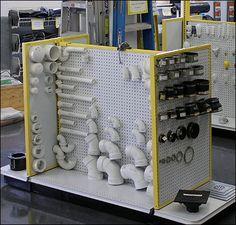 M Fried Plumbing Pegboard Displays Main Furniture Store Display, Electrical Shop, Pegboard Display, Showroom Interior Design, Warehouse Design, Retail Fixtures, Bathroom Showrooms, Store Layout, Retail Store Design