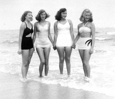 1940s Ladies at the Beach- Swimsuit on the left has a cut out in the center. Right bathing suit top is a bandeau style. #swimsuit #bathingsuit  #1940sfashion