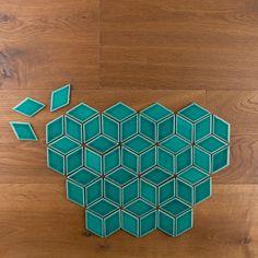 Emerald diamond tiles set in an Escher pattern.