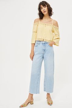 Look to cheerful yellow tones with this charming cold shoulder bardot top. A dream in balmy weather, this graceful crop top features buttons through the front, slender spaghetti straps, pretty crochet trims, and eyelet detailing to the sleeve. Team yours with denim separates for sunny days.