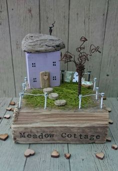 Check out this item in my Etsy shop https://www.etsy.com/uk/listing/499567722/wooden-house-recycled-art-mothers-day