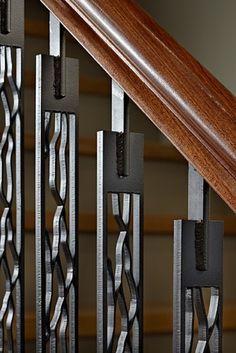 Laser cut steel vertical stairwell supports.