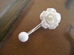 Rose Belly Button Ring Jewelry- White Rose Bud Rosebud Flower Navel Stud Piercing Bar Barbell. $15.00, via Etsy.