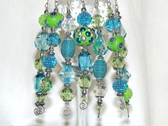 Bead Christmas Ornaments - Turquoise, Lime and Silver Icicles - Set of 7. $22.50, via Etsy.