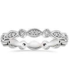 A delicate band with feminine, romantic details.