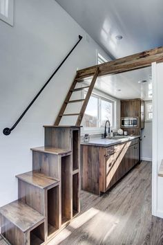 This is the Cocoa Tiny House on Wheels by Modern Tiny Living. It's Cocoa time! With stunning wood throughout, stainless steel countertops, modern black hardware, and tons of storage, Cocoa ma…