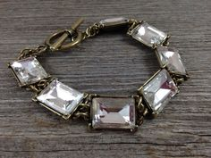 Rectangle Rhinestone Bracelet with antiqued brass and toggle clasp.