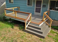Front porch built with wrap around stairs.  Designed and Built by LandArc Landscaping & Design
