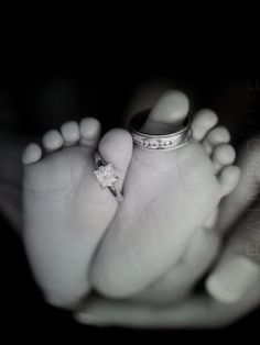 baby photo shoot with mom and dad wedding rings