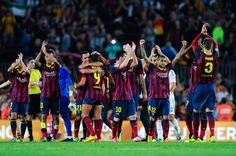 FC Barcelona players celebrate after defeating Real Madrid CF at the end of the La Liga match between FC Barcelona and Real Madrid CF at Camp Nou on October 26, 2013 in Barcelona, Catalonia.