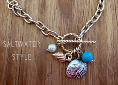 "For the mermaid in all of us! 18"" Toggle necklace filled with dangle charms!"