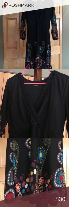 Little Black Dress Cute cute cute!! Little black dress with a splash of color in all the right places. Stylish v neck with winched in waist. Made of a soft cottony fabric. Black lace details the neckline. Wear with black boots or funky heels for a fun look!! Excellent condition. REBORN Dresses Long Sleeve