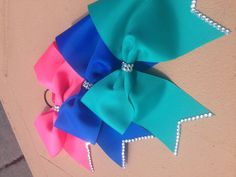 3 inch hand rhinestoned cheer bows or solid bows made to order on Etsy, $10.00
