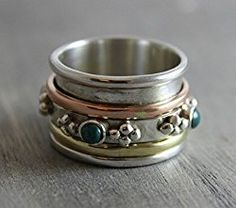 Sterling Silver Ring with brass, copper accents and 3mm turquoise set in sterling silver Reviews This meditation ring is absolutely a joy to wear. It is very comfortable and is an excellent tool for mantra meditation on the go- especially in the car on the way home from work! Beautifully crafted, great quality, and came packaged beautifully with instructions for care. Would highly recommend! Just make sure you order one size up- I ordered a size 6 and it fits like a size 5. Find out more…