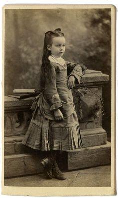 Precious little girl in a fabulous dress.