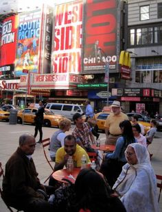 How to not dumbly waste money during long-term travel. Pictured: Times Square, NYC!