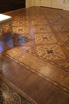 Stenciled; stained faux marquetry floor
