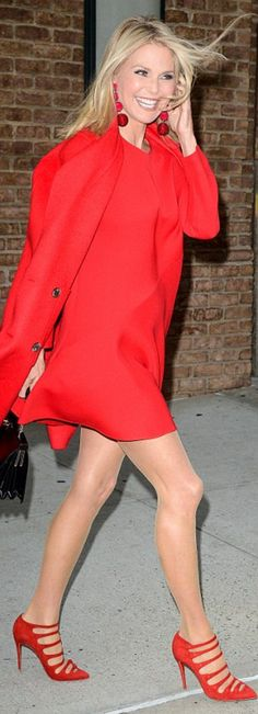 Who made Chrissy Teigen's red long sleeve dress and suede pumps?