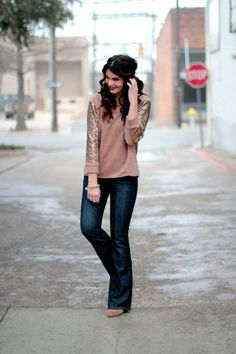 Love the sequins & dark wash jeans. Classic look.