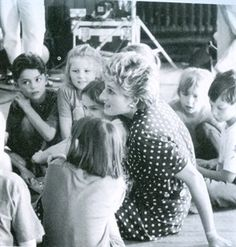 Princess Diana in a rare photo doing what she loved, & did so well ~ loving & advocating for the children of the world, who sadly are so often left behind as the tiniest victims after grown men have finished playing their war games.