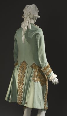 Back view, 3-piece suit, France, c. 1760. Pale green wool plain weave, with sequins and metallic-thread embroidered appliqués; breeches with silk and metallic-thread passementerie.