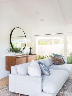 Minimalist Mid-Century living room with grey sofa