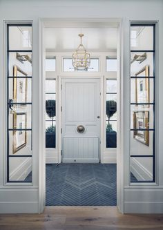 Family Home with Timeless Interiors Foyer Flooring. Foyer with slate floor tile set in herringbone pattern. Foyer opens to living room with wide plank white oak floors. Foyer Flooring, Slate Flooring, Flooring Ideas, Slate Tiles, Entrance Foyer, Entry Hallway, Entry Doors, Entry Tile, Sliding Doors