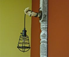 hanging light with hand