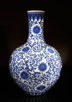 "Chinese Porcelain Vase. Very large, depicting chrysanthemums throughout scroling leaf designs and stiff petals to top and bottom rim. Six character mark in square in blue on underside. 21"" H x 15"" W"