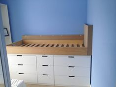 DIY: How to make an Ikea Hack childrens cabin bed with secret den. We built a shelf along the back wall and a custom made headboard using MDF. The post DIY: How to make an Ikea Hack childrens cabin bed with secret den. appeared first on Slaapkamer ideeën. Ikea Hack Bedroom, Bedroom Hacks, Bedroom Decor, Ikea Shelf Hack, Bedroom Ideas, Bed Storage, Bedroom Storage, Storage Ideas, Nordli Ikea