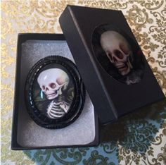 Jennybird Alcantara made a beautiful Victorian inspired Jet-like carved resin brooch, featuring a snippet from her work. This is the { Skeleton } brooch..