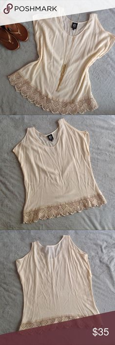 """Bobeau Boho Sleeveless Cold Shoulder Ivory Top Excellent used condition. Sleevless Cold Shoulder Top by Bobeau in a gorgeous ivory color. Loose, boho fit with peekaboo cutout shoulder detail. 100% rayon that feels super lightweight and """"crepe-y"""" with crochet trim at the bottom hem. Size medium, see photos for measurements. bobeau Tops"""