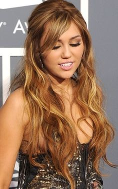 Miley Cyrus hair is beautiful. Tried matching it up with Goldwell hair color. Have head of high lights using 30 silk lift. Couple 6n low lights. Rinse. Tone all over equal parts of 8G & 7G colorance. Beautiful color, very natural. Gold.