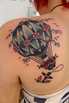 I love the coloring and outline of this hot air balloon tattoo! Although I would leave out the anchor.. Be free!