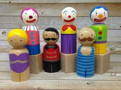 Circus Peg Doll Set Set of 6 by PeggedByGrace on Etsy..he ringmaster invites you to the greatest show on earth - complete with a heart stopping trapeze act, hilarious clowns, and a seriously impressive strongman. As well as being wonderful toys, these peg dolls would look amazing on top of a birthday cake!