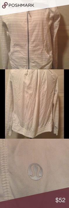 Lululemon Contempo Jacket Zip front with white on white stripes and lulu logo around front, back is a looser silken panel for breathable movement. Size 8 , no stains, pilling or visible wear. Elastic waist and cuffs lululemon athletica Tops Sweatshirts & Hoodies