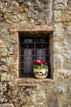 Old stone wall building in a Tuscan village, Italy