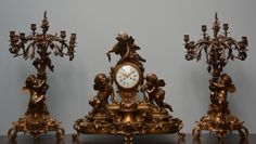Lot 690: An exceptional Nap III bronze sculptural garniture, the dial marked 'Leguéret Paris', H 73 - W 77,5 - D 32 cm / H 88 cm  € 6.000 - € 10.000