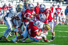 The St. Ignatius defense swarms a Mitty ball-carrier on Saturday at St. Ignatius Prep. (Photo by Devin Chen)
