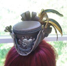 Steampunk Brown Satin Mini Tricorn Pirate hat w/hearts. $65. https://www.etsy.com/listing/151624716/steampunk-brown-satin-mini-tricorn?ref=shop_home_active