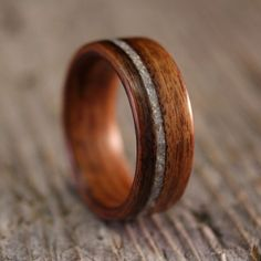 I think this would be a really pretty guy's engagement ring. Handcrafted wooden ring with crushed mother of pearl inlay.
