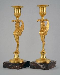 "Pair of #candlesticks ""return from Egypt"" in #gilded #bronze decorated with winged women. Veined #red #marble base. #Empire, 19th century. For sale on #Proantic by Clock Prestige."