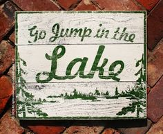 Go Jump in the Lake rustic signs on plank wood.