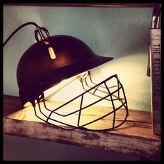 Upcycled lamp made out of an old cricket helmet... More where this came from here... Www.salvagesister.co.uk by Charis Williams #LampUpcycle